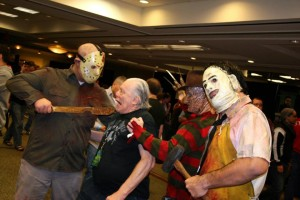 Jason menacing Ted White (who played Jason in Friday the 13th Part IV), as Freddy and Leatherface assist.