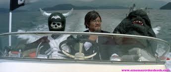 The Drill Beast escorts the Professor to Wicked Dragon Mom's headquarters